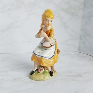 Porcelain Girl Sitting with a Basket Figurine